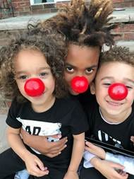 Drew, age 4, Nyiaar, age 12, Kane, age 6, wearing their Red Nose Day noses.