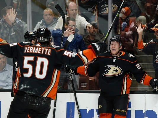 Anaheim Ducks right wing Ondrej Kase, right, of Czech Republic, celebrates his goal with center Antoine Vermette (50) during the second period of an NHL hockey game against the Ottawa Senators in Anaheim, Calif., Wednesday, Dec. 6, 2017. (AP Photo/Alex Gallardo)