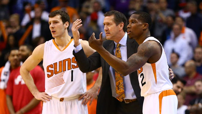 Suns head coach Jeff Hornacek (center) reacts alongside guard Eric Bledsoe (2) and guard Goran Dragic (1) in the fourth quarter against the Portland Trail Blazers at US Airways Center. The Suns defeated the Blazers 118-113.