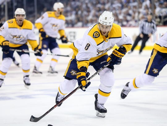 Nashville Predators center Kyle Turris (8) skates with