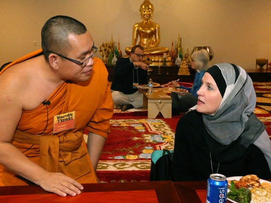 The Venerable Monk Preeda Momungkun, left, talks with Robin Abudiab during an Interfaith Community Lunch sponsored by MTSU on Friday, Jan. 15, 2016.