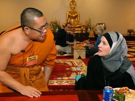 The Venerable Monk Preeda Momungkun, left, talks with