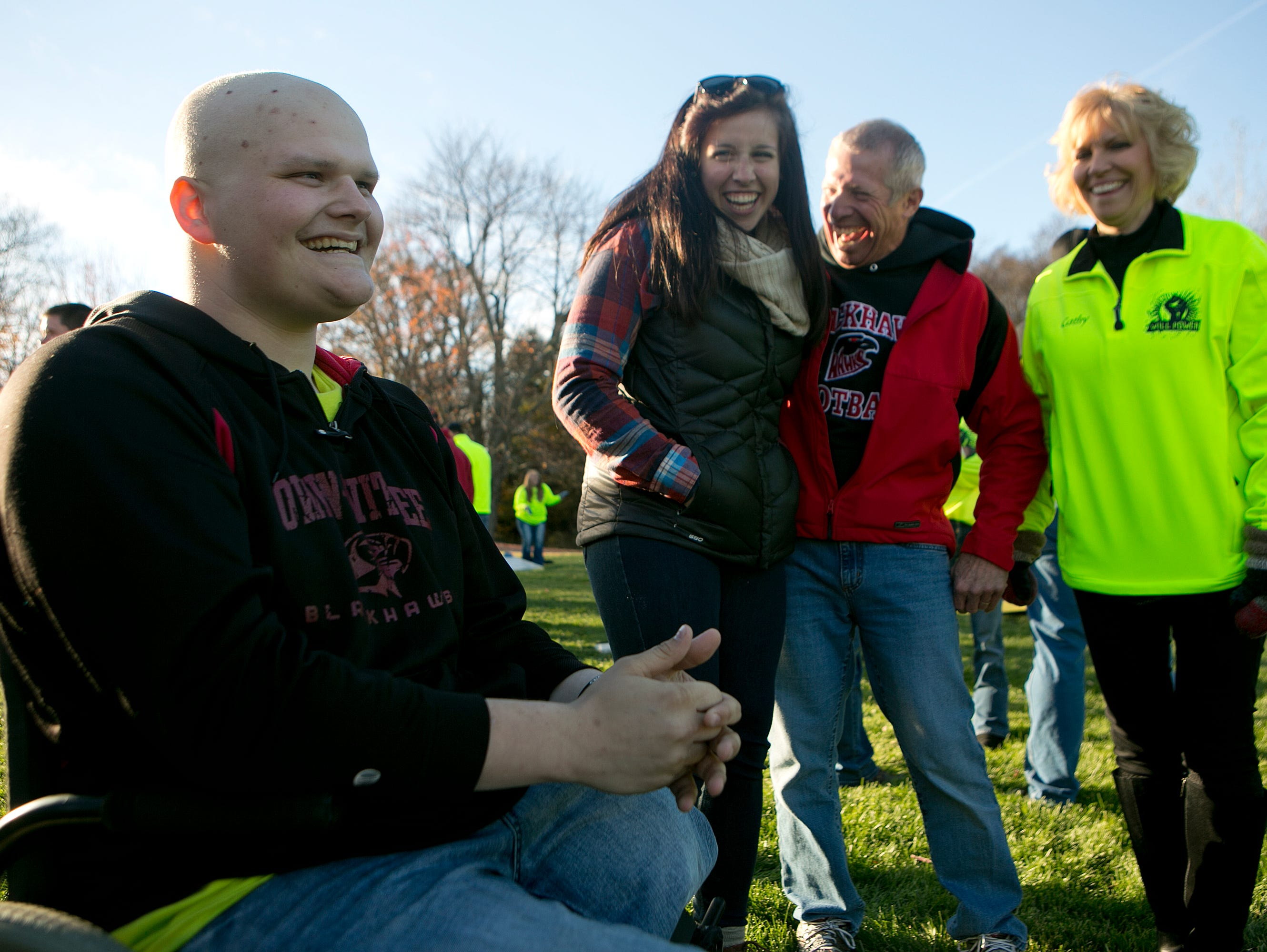 From left, Will Maki shares a laugh with friend Bailey Karaba, Owen-Withee football coach Terry Laube and his wife Cathy Laube during the Will Power fundraiser at Munson Bridge Winery in Withee, Saturday, Oct. 17. Maki was diagnosed with Osteosarcoma bone cancer in his femur in July and had to have his leg amputated in September. He was a member of the Owen-Withee football team that won the state championship in 2014.