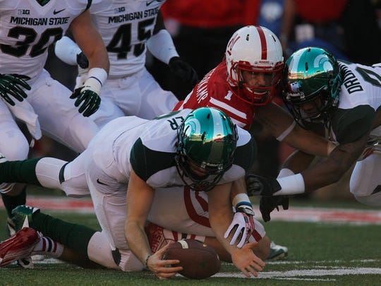 MSU's Taybor Pepper (52) recovers a Nebraska fumble during the Spartans' 41-28 win on Nov. 16, 2013.