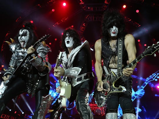 Gene Simmons,  from left, Tommy Thayer and Paul Stanley of KISS are playing cities on their Freedom to Rock Tour that haven't had a tour stop in 10 years or more. The band lands Wednesday at the Resch Center for its first Green Bay concert in 26 years.