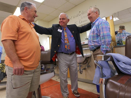 Alan Grubb, left, Col. Sandy Edge, middle, and Joe Tankersley, right, share a conversation about memories of the barbershop at The Clemson House at Clemson University on Thursday. The barbershop is open through Monday, but then will be closed by the University as The Clemson House is budgeted for demolition.