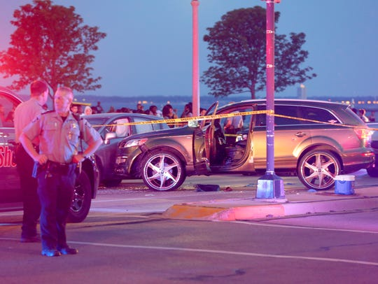 Milwaukee County sheriff's deputies respond to a deputy-involved shooting near Bradford Beach in Milwaukee on East Water Tower Road and North Lincoln Memorial Drive in June 11, 2017.