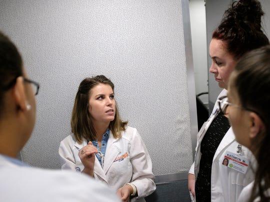 Nurse practitioner Megan Kyle instructs students Latasha Turner, Gracie Simon and Kate Morrow at the Clemson University mobile clinic on Wednesday, Oct. 4, 2017.