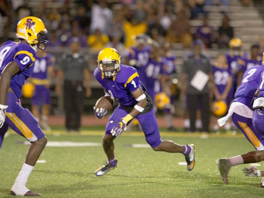 Jayvion Mitchess (1) of St. Martinville looks for a