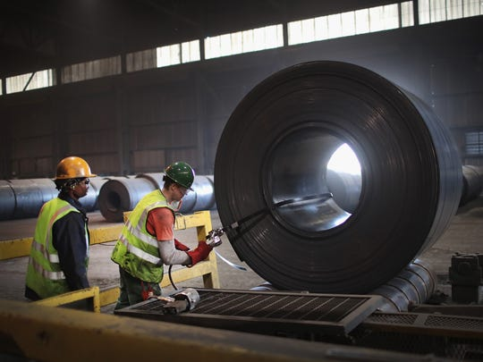 American steel: The 25% tariff on steel has bolstered the economic case for using locally made steel. Moody's Investors Service on May 31, 2018 raised its outlook for the U.S. steel industry from stable to positive, in part due to the tariff decision.Workers band a steel coil that was set aside for quality-control testing during steel production at the NLMK Indiana steel mill on March 15, 2018 in Portage, Indiana.
