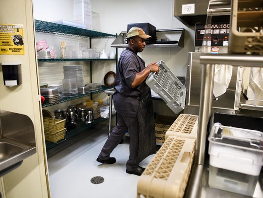 Fred Turner washes dishes at Kitchen Sync on Thursday,