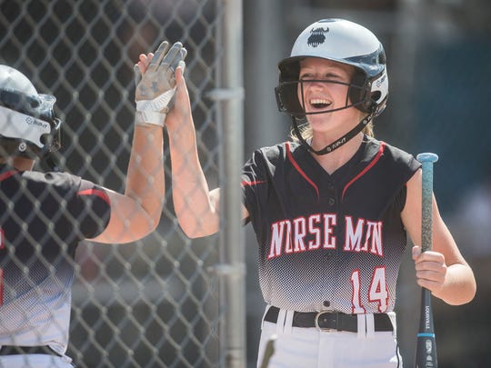 Roland-Story's Madison Geise gets a high-five after scoring during the Class 3A state softball championship between Davenport Assumption and Roland-Story on Friday, July 20, 2018, at the Rogers Sports Complex in Fort Dodge.