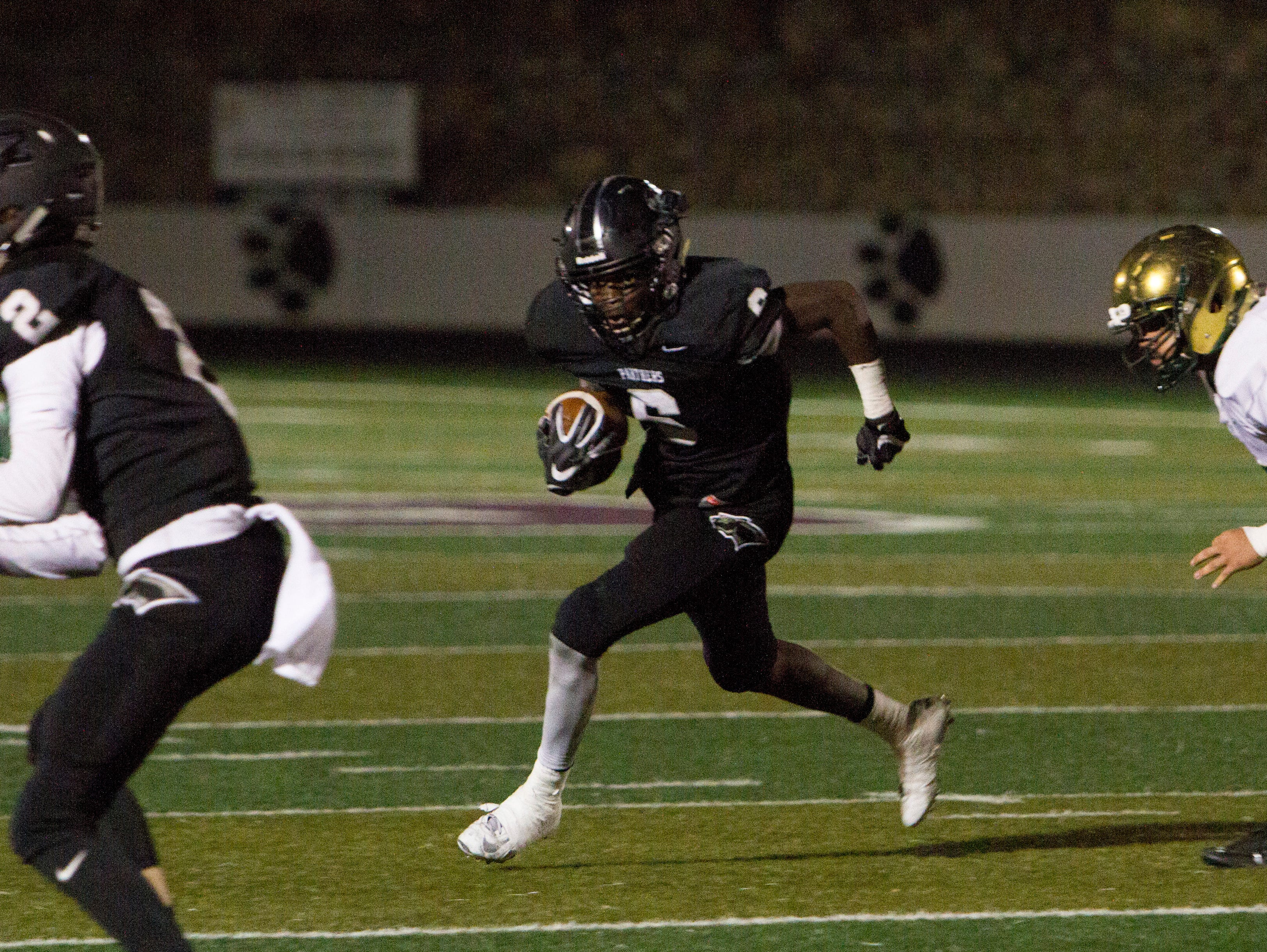 Pine View wide receiver Jacob Mpungi makes a run for yards against Snow Canyon Friday, Sept. 23, 2016.