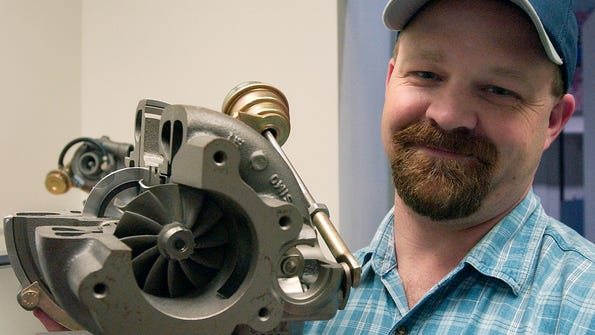 Worker Brian Allen is shown at BorgWarner Turbo Systems on Brevard Road in this 2004 photo.