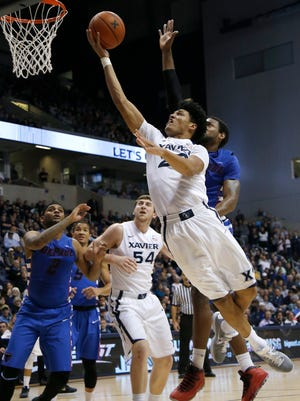 Xavier forward Kaiser Gates scores on a layup against DePaul.