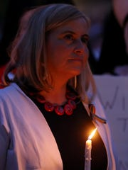 Mayor Megan Barry holds a candle following her remarks at a vigil held Sunday June 12, 2016, in Public Square in honor of the victims of the Orlando, Fla., attack.