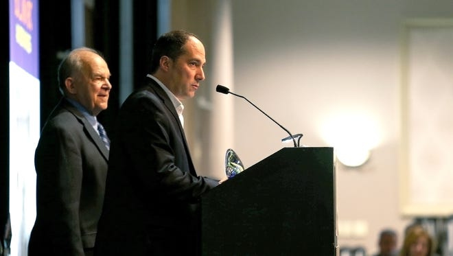 Steve and Leon Anastos, of the Riverdale Banquet Hall, receive the 2018 Restorative Award during the Greater Binghamton Chamber of Commerce 2018 Economic Outlook and Building BC Awards, held on Tuesday, February 13, 2018, at the Holiday Inn in downtown Binghamton.
