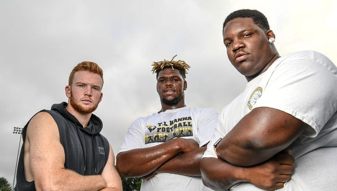 TL Hanna High seniors, from left; quarterback Alex Meredith, defensive end Zacch Pickens, and defensive lineman Devonte Jones.