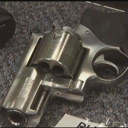 Gun close-up - Stock Photo