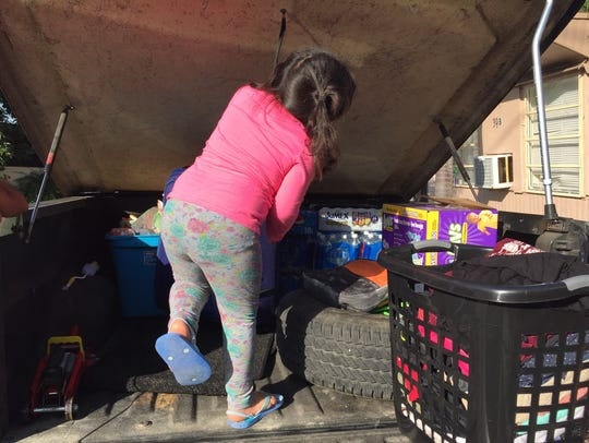 The 4-year-old daughter of Jose Luis Martinez helps