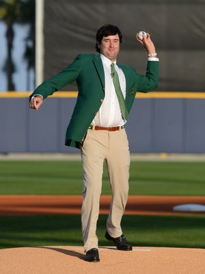 Bubba Watson throws out the first pitch at Blue Wahoos game in 2014 after winning The Masters Tournament for a second time.