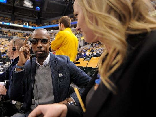 Michael Grady, public address announcer, tries out Google Glass prior to the Indiana Pacers against the Miami Heat inside Bankers Life Fieldhouse, Wednesday, March 26, 2014, in Indianapolis.