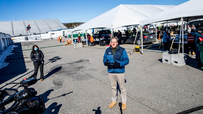 Gov. Chris Sununu holds a news conference outside the COVID-19 vaccination tent at the New Hampshire Motor Speedway on Saturday.