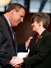 New Jersey Gov. Chris Christie, left, greets Sen. Joni
