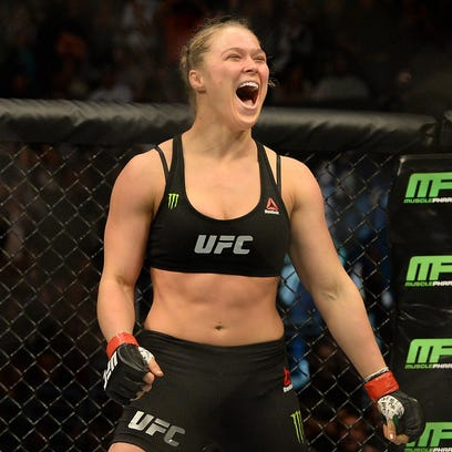 Ronda ROusey retained her UFC bantamweight title and stayed unbeaten.