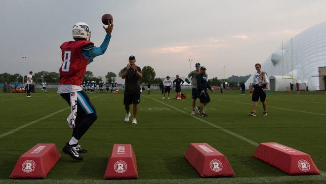 Titans quarterback Marcus Mariota (8) throws a pass during a night training camp practice at Saint Thomas Sports Park on Monday, Aug. 7, 2017.