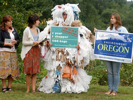 The Bag Monster, representing the how many plastic bags each person is estimated to use each year, was on hand Wednesday for the kick off of Environment Oregon's campaign to ban the bags' use.  KOBBI R. BLAIR / Statesman Journal Environment Oregon kicked off a campaign featuring Bag Monster Wednesday July 31, 2013 at Salem's Riverfront Park to get the Salem City Council to pass an ordinance banning disposable plastic bags.