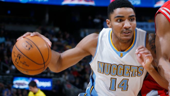 Denver Nuggets guard Gary Harris, left, drives for a shot against the Houston Rockets on March 7, 2015, in Denver.