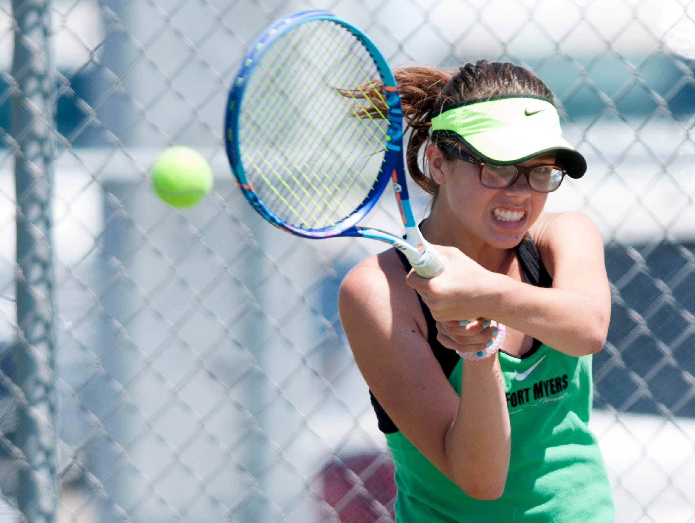 Marina Lombardo, of the Fort Myers High School tennis team, makes a return while competing against Barron Collier's Tori Franklin during the Region 3A-3 girls tennis regional semifinal on Tuesday.
