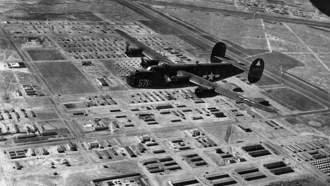 A B-24 flies over Alamogordo Army Air Field, now Holloman Air Force Base, during the 1940s. The airfield served as a training site for 19 bombardment groups and 73 bombardment squadrons flying B-24s and B-29s.The open airspace of 38 miles wide and 64 miles long between the Sacramento, Organ and San Andres Mountains were a bonus for the increased training required by the Army Air Forces.