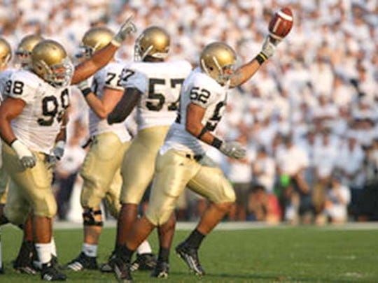 Palmyra grad Joe Brockington recovers a fumble against Penn State during the 2007 season.