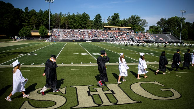 The Class of 2020 begins the procession on to the football field during Sacred Heart Griffin's in-person graduation ceremony for the Class of 2020 at Ken Leonard Field, Sunday, July 19, 2020, in Springfield, Ill.