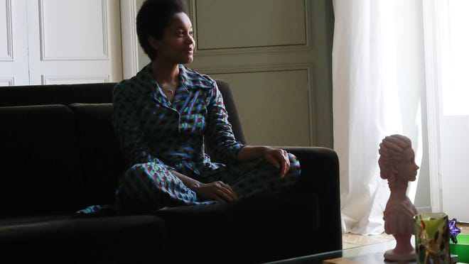 Tamu McPherson sits on the sofa at her home in Milan, Italy, on June 16.