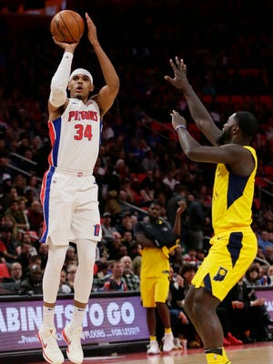 Detroit Pistons forward Tobias Harris (34) takes a shot against Indiana Pacers guard Lance Stephenson during the first half of an NBA basketball game, Tuesday, Dec. 26, 2017, in Detroit.