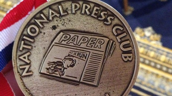 A close-up of the first place medal for the female 20-24 age group.