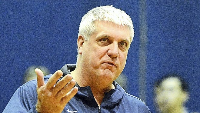 York Suburban coach Tom Triggs, seen here in a file photo, hopes the team's height can help the Trojans improve on a 1-21 record from last season. DISPATCH FILE PHOTO
