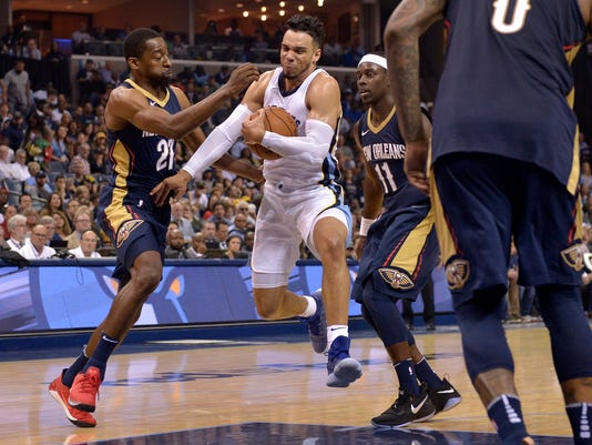 Memphis Grizzlies forward Dillon Brooks, center, drives between New Orleans Pelicans guards Jordan Crawford (27) and Jrue Holiday (11) during the second half of an NBA basketball game Wednesday, Oct. 18, 2017, in Memphis, Tenn. (AP Photo/Brandon Dill)