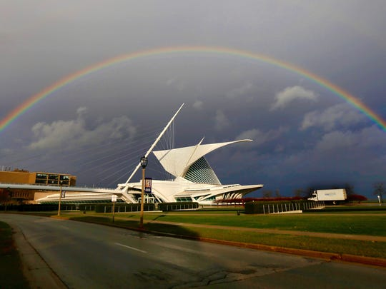 A rainbow arcs over the Milwaukee Art Museum in Milwaukee on Wednesday November 15, 2017 during a brief period of sun in an otherwise dreary day.