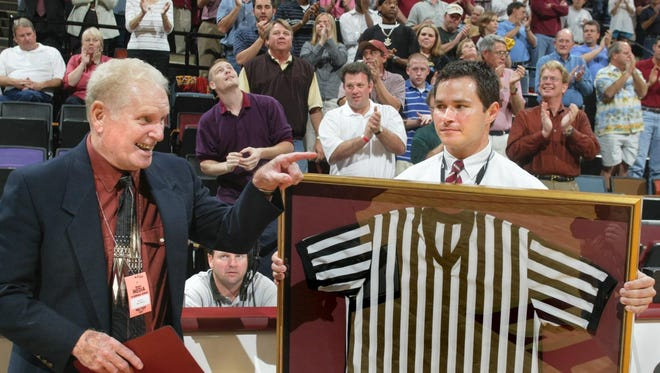 Bob Albertson, 78, is given a referee's jersey by FSU during a 2005 basketball game against Miami. Albertson spent 44 years while also working 43 years as Florida High's head basketball coach.