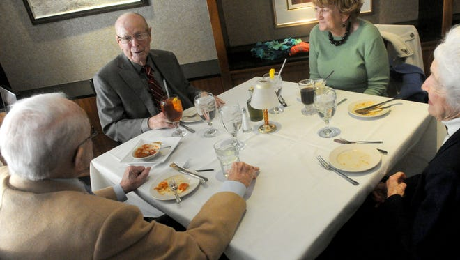 Dick Dickerson and Kay McDonagh of Staunton eat lunch with friends Kitty Wood and Chuck Jones at Emilio's in downtown Staunton on Sunday, March 3, 2013.