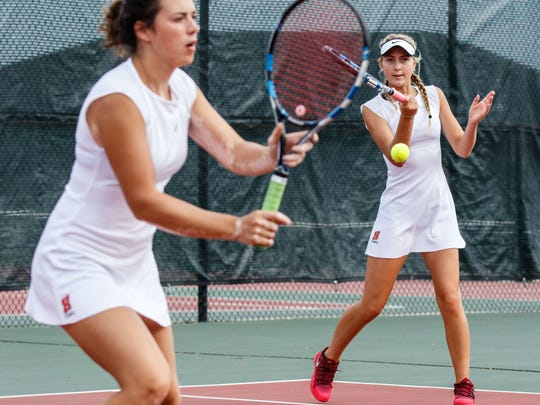 Homestead No. 1 doubles players Alyssa Boyer (left) and Frankie La Londe compete in the WIAA tennis subsectional at Homestead on Monday, Oct. 2, 2017.