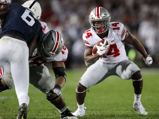Sep 29, 2018; University Park, PA, USA; Ohio State Buckeyes wide receiver K.J. Hill (14) runs with the ball during the third quarter against the Penn State Nittany Lions at Beaver Stadium. Ohio State defeated Penn State 27-26. Mandatory Credit: Matthew O'Haren-USA TODAY Sports