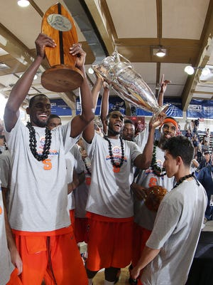 Syracuse Orangemen celebrate with the trophies after defeating the Baylor Bears to win the championship game of the EA Sports Maui Invitational at  the Lahaina Civic Center.
