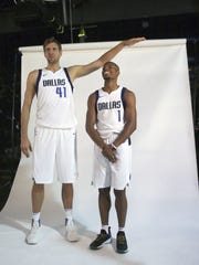 Dallas Mavericks forward Dirk Nowitzki (41) of Germany jokingly poses for a photo with new teammate guard Dennis Smith Jr. (1) during an NBA basketball team media day in Dallas, Monday.