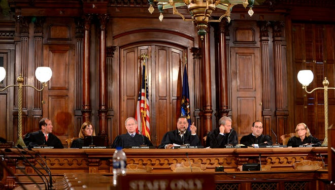 The Michigan Supreme Court listens to oral arguments for the Bernstein v. Seyburn case Tuesday, October 13, 2015, in the court's old quarters in the Capitol Building. The court heard that case at the Capitol before moving back to the Hall of Justice to hear the other cases.