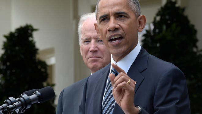 President Barack Obama, accompanied by Vice President Joe Biden, speaks about the election results, Wednesday, Nov. 9, 2016, in the Rose Garden at the White House in Washington.